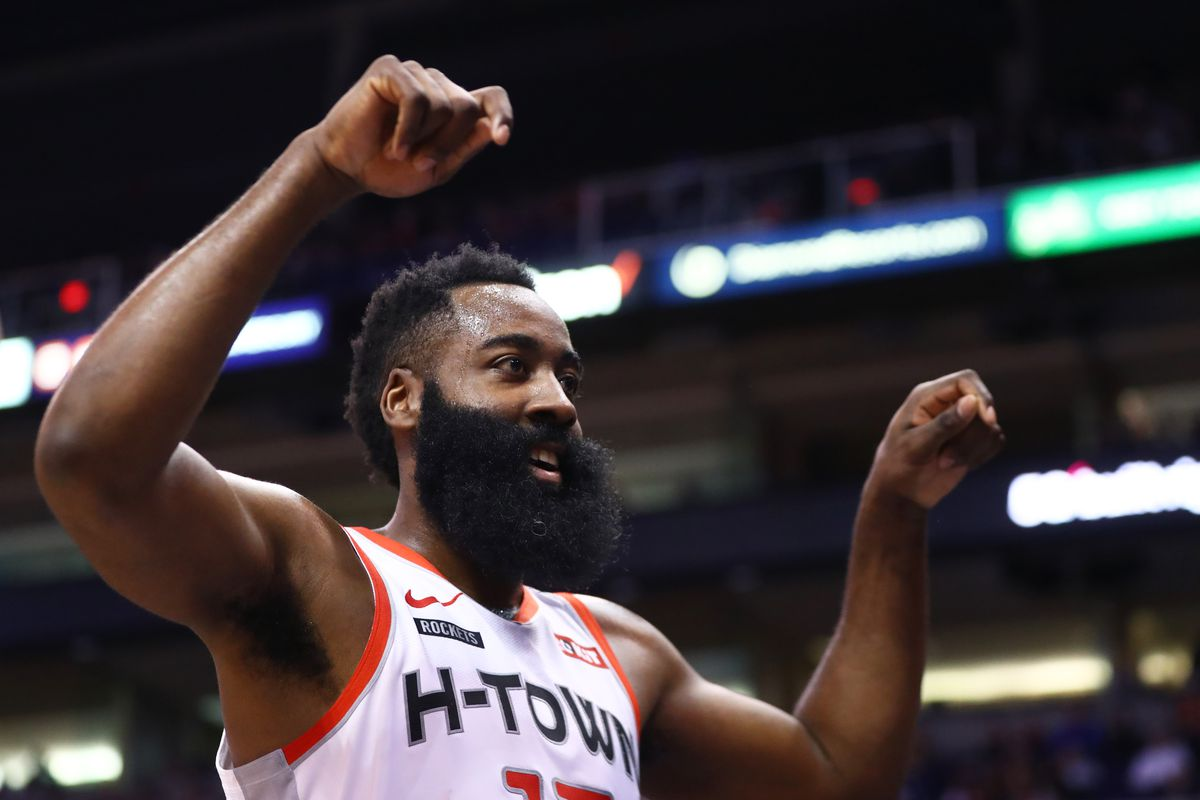 Houston Rockets guard James Harden celebrates in the closing minutes of the game against the Phoenix Suns at Talking Stick Resort Arena.