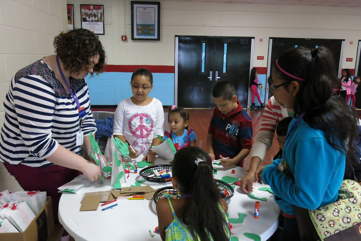 Students participate in a craft at a joint event between Metropolitan Nashville Public Schools and the Nashville Public Library to teach immigrant families about the public library system.