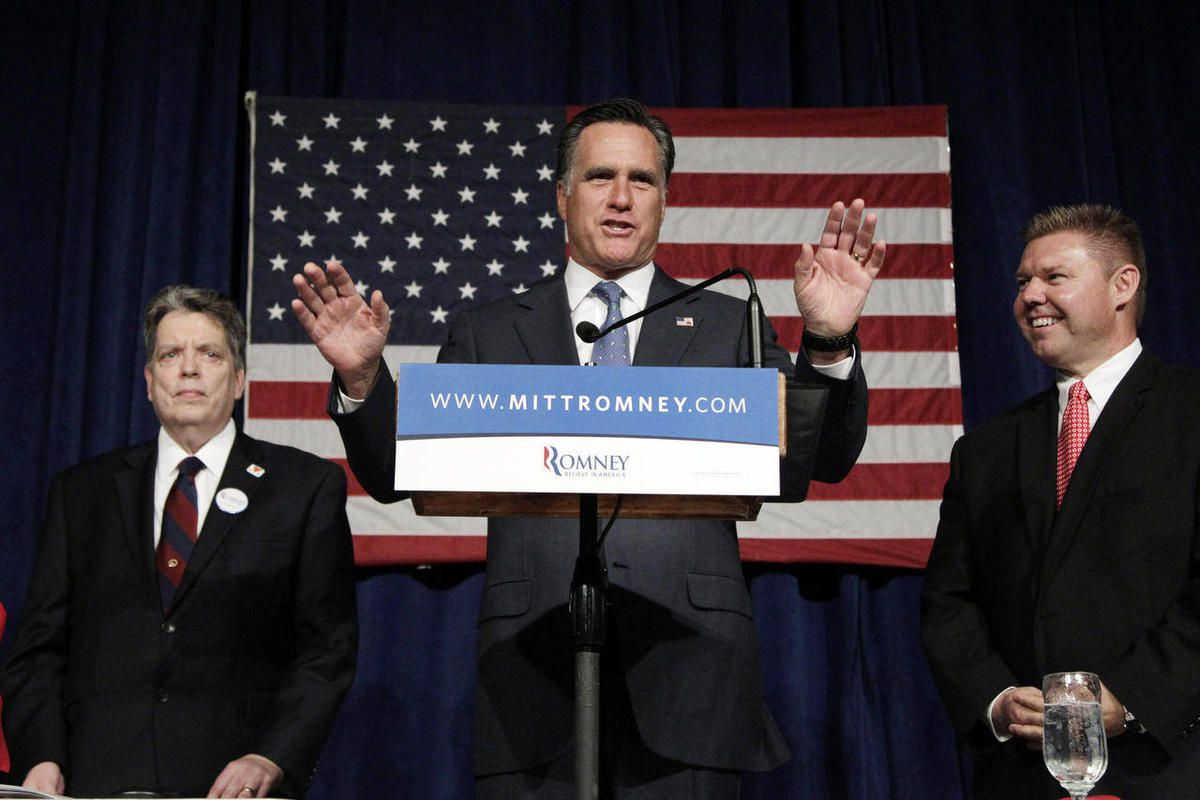 Republican presidential candidate, former Massachusetts Gov. Mitt Romney, center, gestures as he asks supporters to take a seat at the Franklin County Lincoln Day Dinner in Greencastle, Pa., Sunday, April 22, 2012.