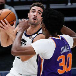Utah Jazz forward Georges Niang (31) makes a layup attempt against Phoenix Suns center Damian Jones (30) during an NBA preseason game at Vivint Smart Home Arena in Salt Lake City on Saturday, Dec. 12, 2020.