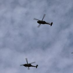 A group of Utah Air National Guard helicopters do a flyover after Utah Gov. Spencer Cox and other state officials took the oath of office during an inaugural ceremony at Tuacahn Center for the Arts in Ivins, Washington County, near St. George on Monday, Jan. 4, 2021.