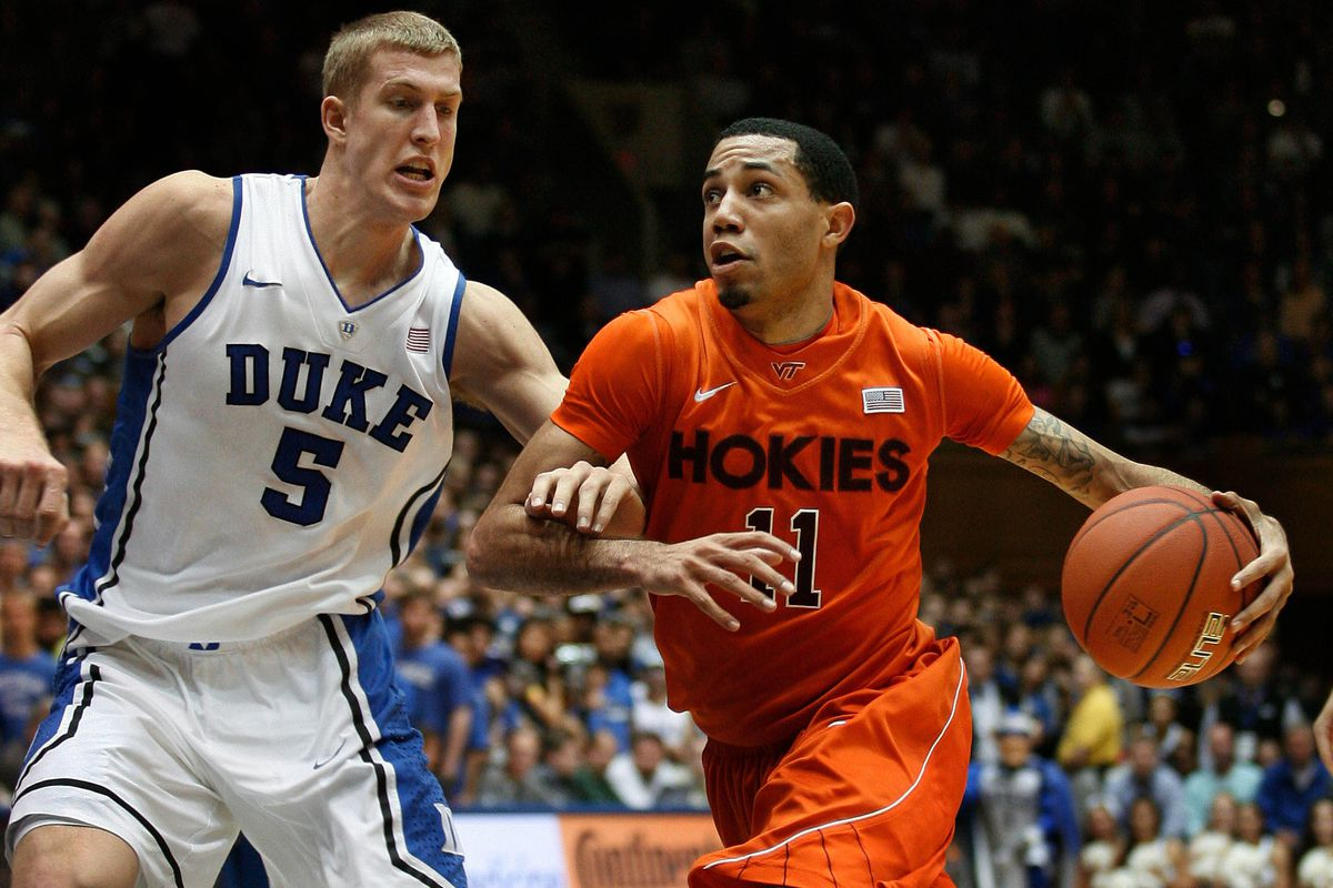 Erick Green driving in Miles Plumlee - both guys are now NBA players.