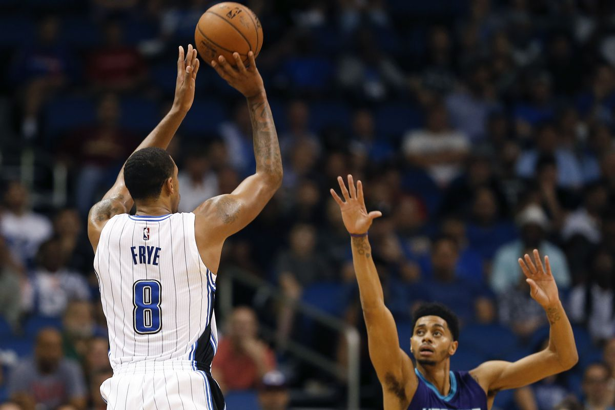 Channing Frye pulls up over Jeremy Lamb in the Magic's 113-98 win against the Hornets Wednesday night.