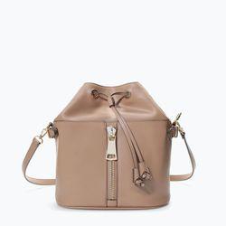 "Zara zipped bucket bag, <a href=""http://www.zara.com/us/en/shoes---bags/woman/handbags/zipped-bucket-bag-c665016p2037022.html"">$79.90</a>"