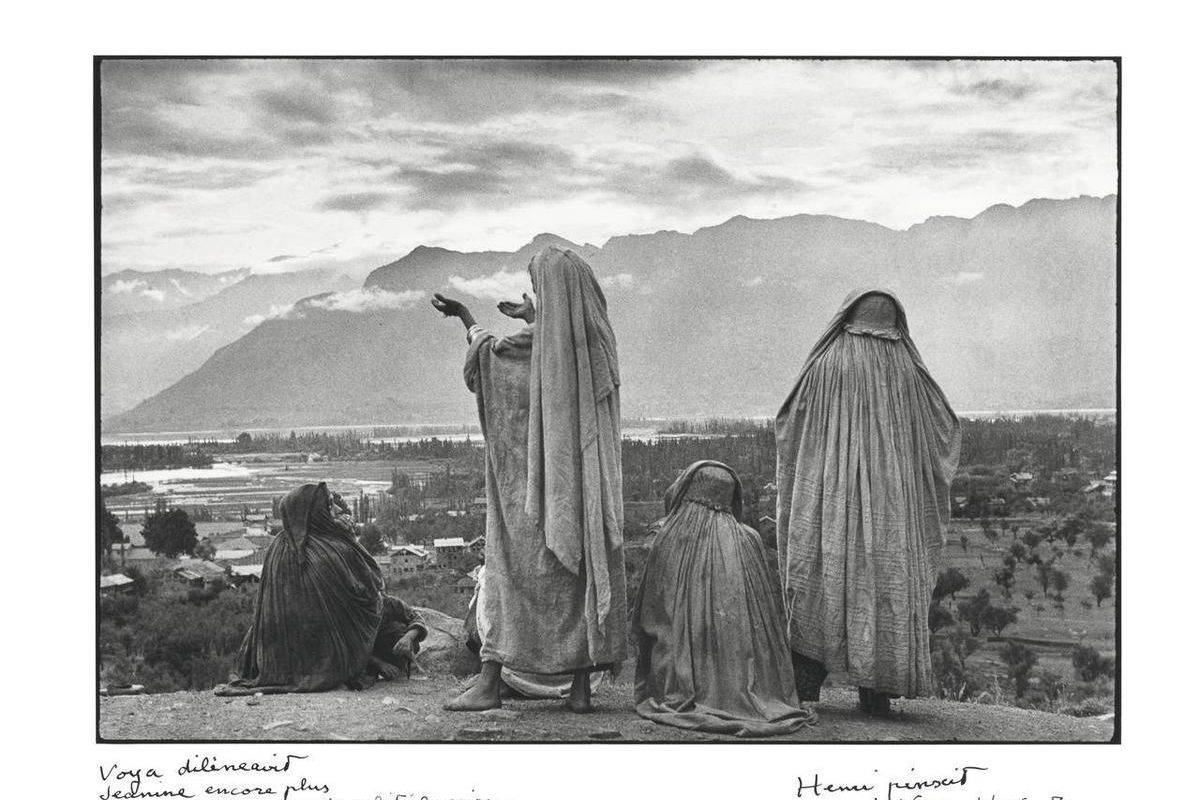 In this image released by Christie's auction house, Tuesday, Sept. 4, 2012, is a signed photograph by Henri Cartier-Bresson taken in 1948 in Srinagar, India. One man alone was responsible for printing the vast majority of his black-and-white photos betwee