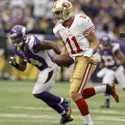 San Francisco 49ers quarterback Alex Smith (11) scrambles for yardage during the second half of an NFL football game against the Minnesota Vikings Sunday, Sept. 23, 2012, in Minneapolis. The Vikings won 24-13.