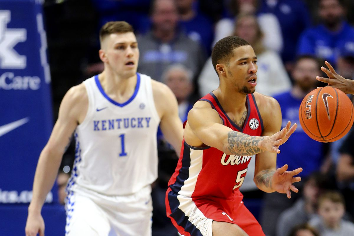Ole Miss Rebels forward KJ Buffen passes the ball against Kentucky Wildcats forward Nate Sestina in the second half at Rupp Arena.