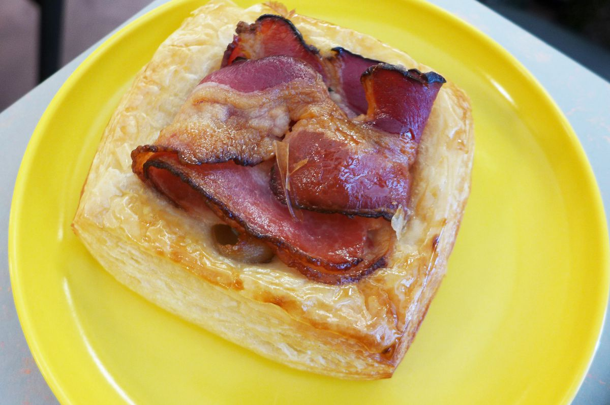 A single square Danish stuffed with bacon.
