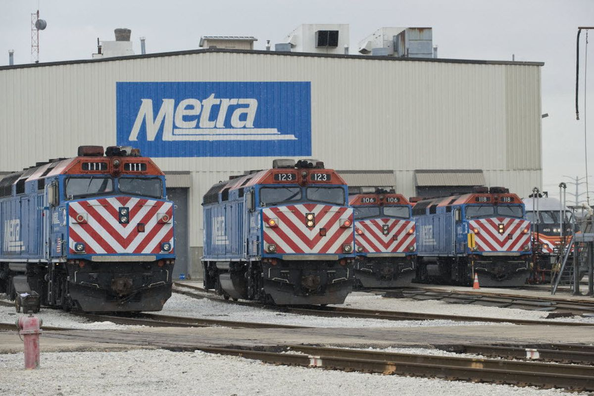 Train cars sit in front of a Metra station in the snow. With the COVID-19 pandemic and a focus on working remotely, Metra's monthly ridership has declined significantly during the last year,