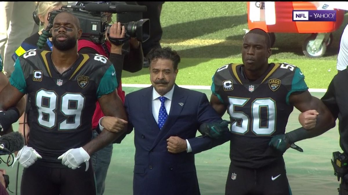 The owner of the Jacksonville Jaguars football team, Shahid Khan, linked arms with his players during the national anthem.