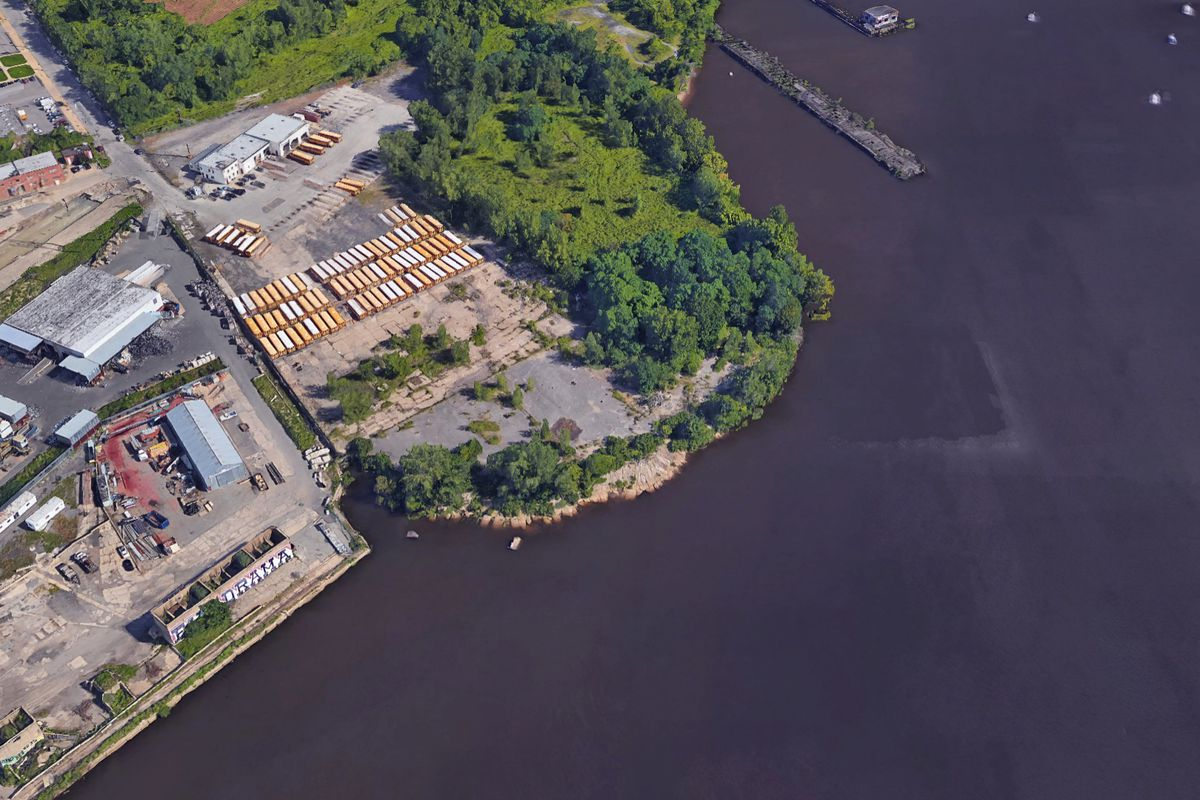 An aerial view of an overgrown riverfront in Philadelphia.