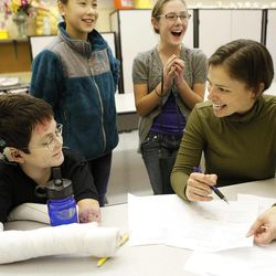 In a Nov. 22, 2011 photo, seventh-grader Shane DiGiovanna smiles when he finds out that he has the highest grade in the class so far on a geography quiz at Seven Hills School in Cincinatti.  Grading the quiz is teacher Elissa Donovan.  In the rear are seventh-grades Katie Corbett, left, and Matisse Peppet.   DiGiovanna has a severe, rare skin disease called Epidermolysis Bullosa which makes his skin blister and tear easily. The Montgomery teen spends each day with 40 percent of his body wrapped in bandages. Shane is obsessed with NASA and wants to work for it some day and be involved in space exploration.