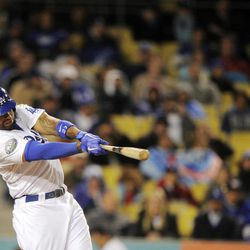 Los Angeles Dodgers' Matt Kemp hits a two-run home run during the fifth inning of their baseball game against the San Diego Padres, Friday, April 13, 2012, in Los Angeles.