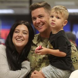 Amelia Dansie, Sgt. James Dansie and their son Keaton Dansie pose for a photo at the Salt Lake International Airport in Salt Lake City on Tuesday, Aug. 27, 2019, as Sgt. Dansie and other members of the Utah National Guard's 4th Infantry Division Main Command Post Operational Detachment return home after serving in Afghanistan for 10 months in support of Operation Freedom's Sentinel.