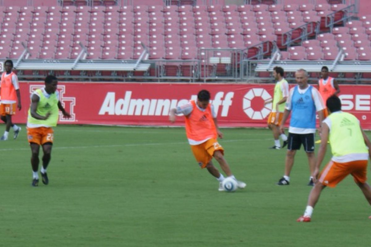 Juan Manuel Quevedo takes on defenders in a drill during Dynamo practice.