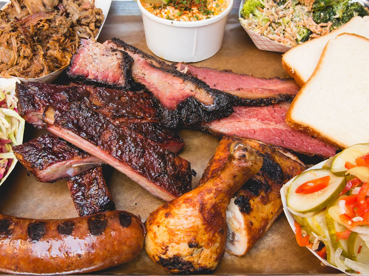 A smattering of barbecue meats and side dishes