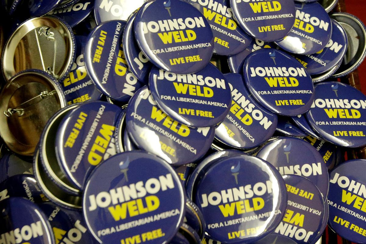 Campaign buttons for Libertarian presidential candidate Gary Johnson and vice presidential candidate Bill Weld at the National Libertarian Party Convention, Friday, May 27, 2016, in Orlando, Fla.