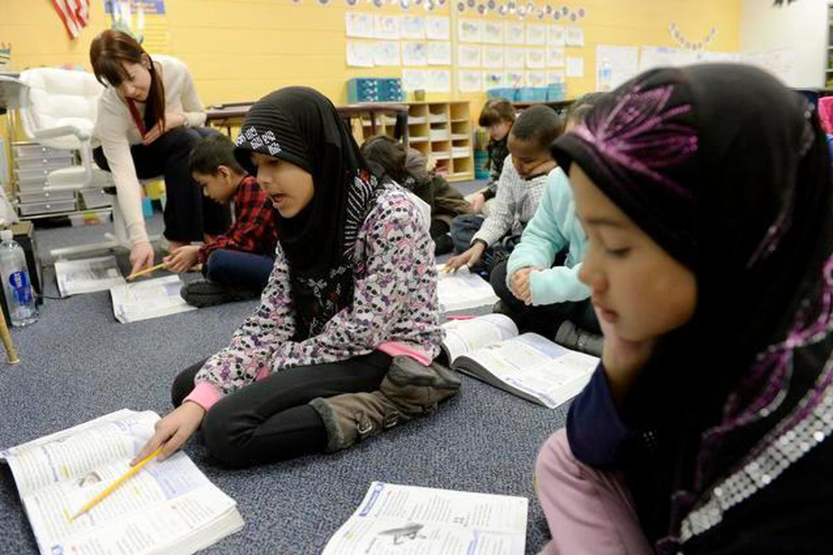 Louise Kreuzer, top left, teaches third-graders in a newcomer classroom at Place Bridge Academy in Denver.
