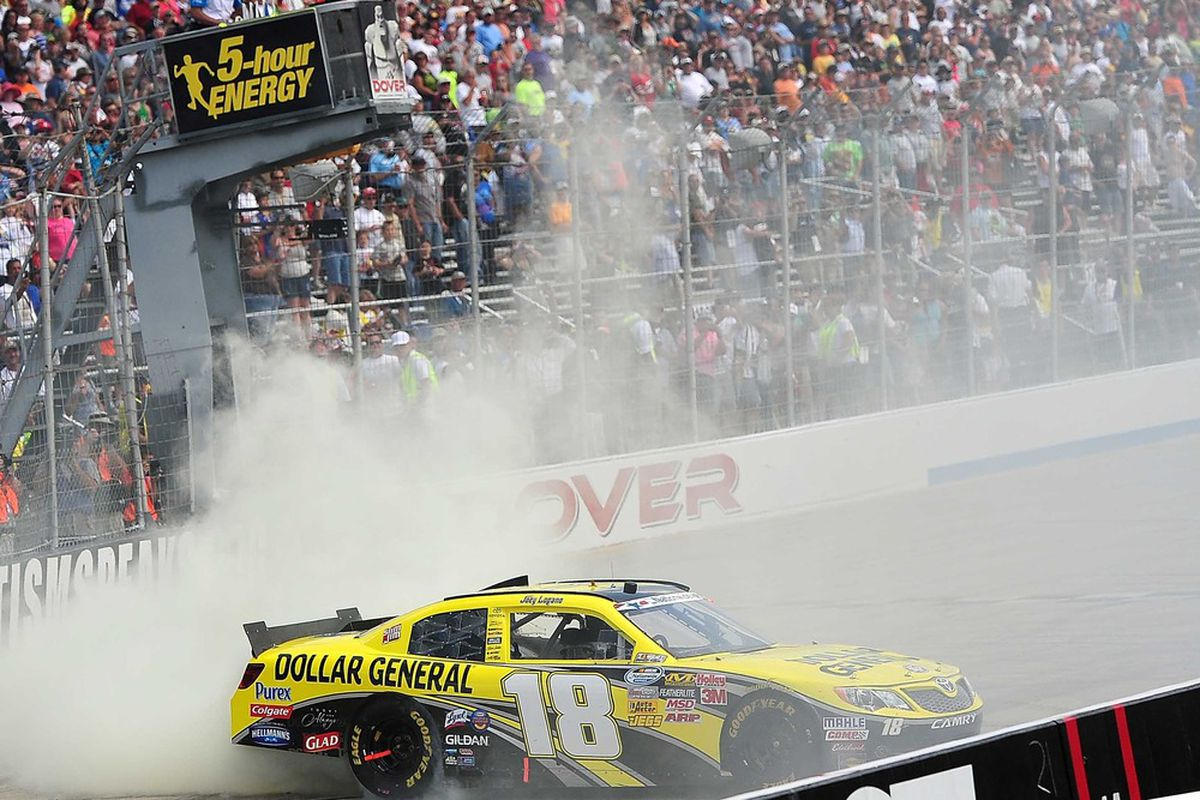 June 2, 2012; Dover, DE, USA; NASCAR Nationwide Series driver Joey Logano (20) burns out after winning the 5-hour Energy 200 at Dover International Speedway. Mandatory Credit: Andrew Weber-US PRESSWIRE