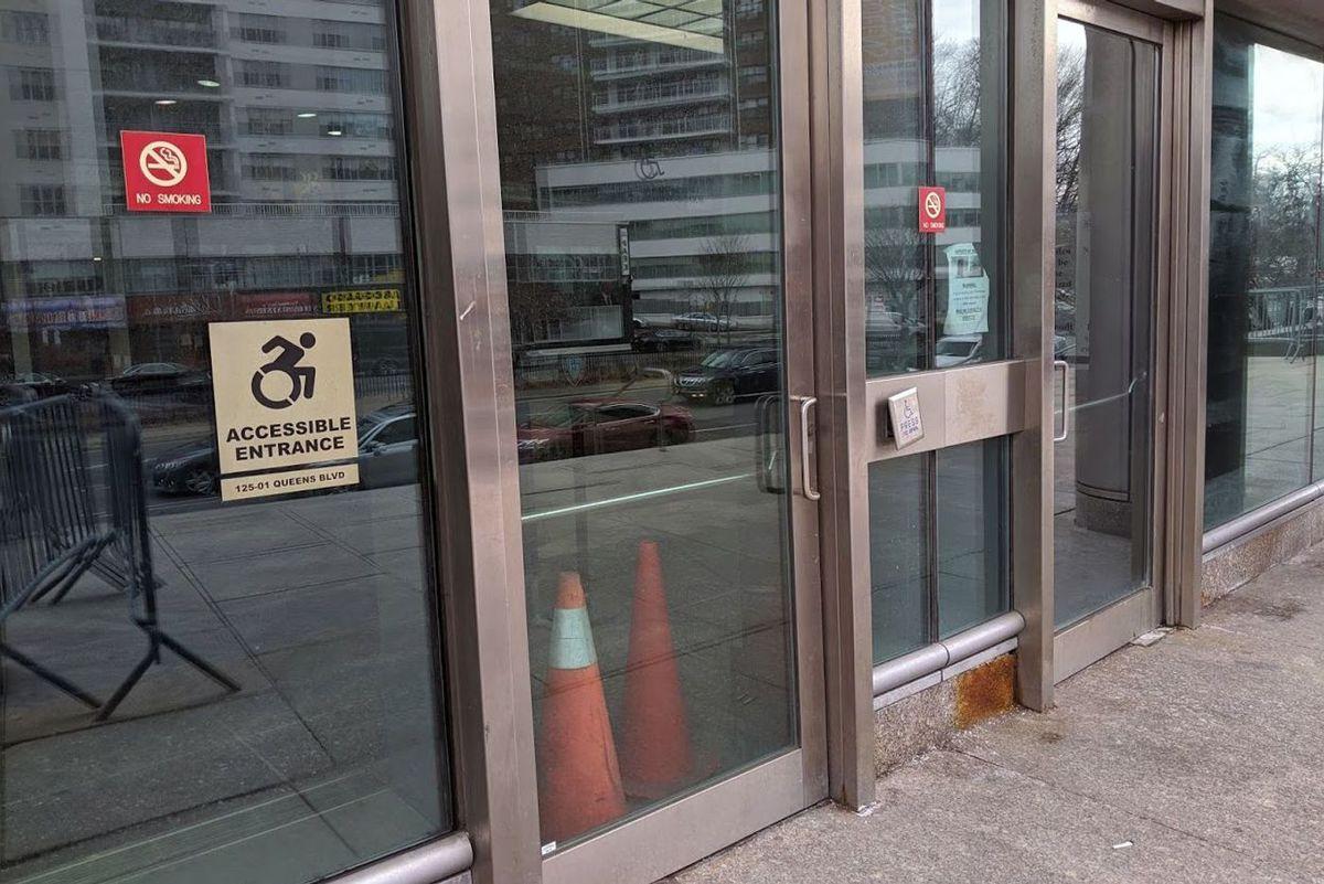 Broken Queens Criminal Court automatic door