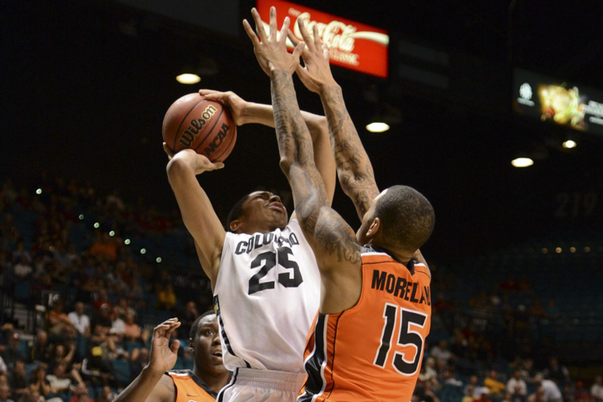 Colorado's Spencer Dinwiddie scores 2 of his game high 20 points over Oregon St.'s Eric Moreland, as the Buffs moved past the Beavers to the second round of the Pac-12 Tournament in Las Vegas.