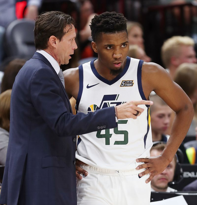 Utah Jazz head coach Quin Snyder talks with guard Donovan Mitchell as the Jazz and the Perth Wildcats play in an exhibition basketball game at Vivint Arena in Salt Lake City on Saturday, Sept. 29, 2018.