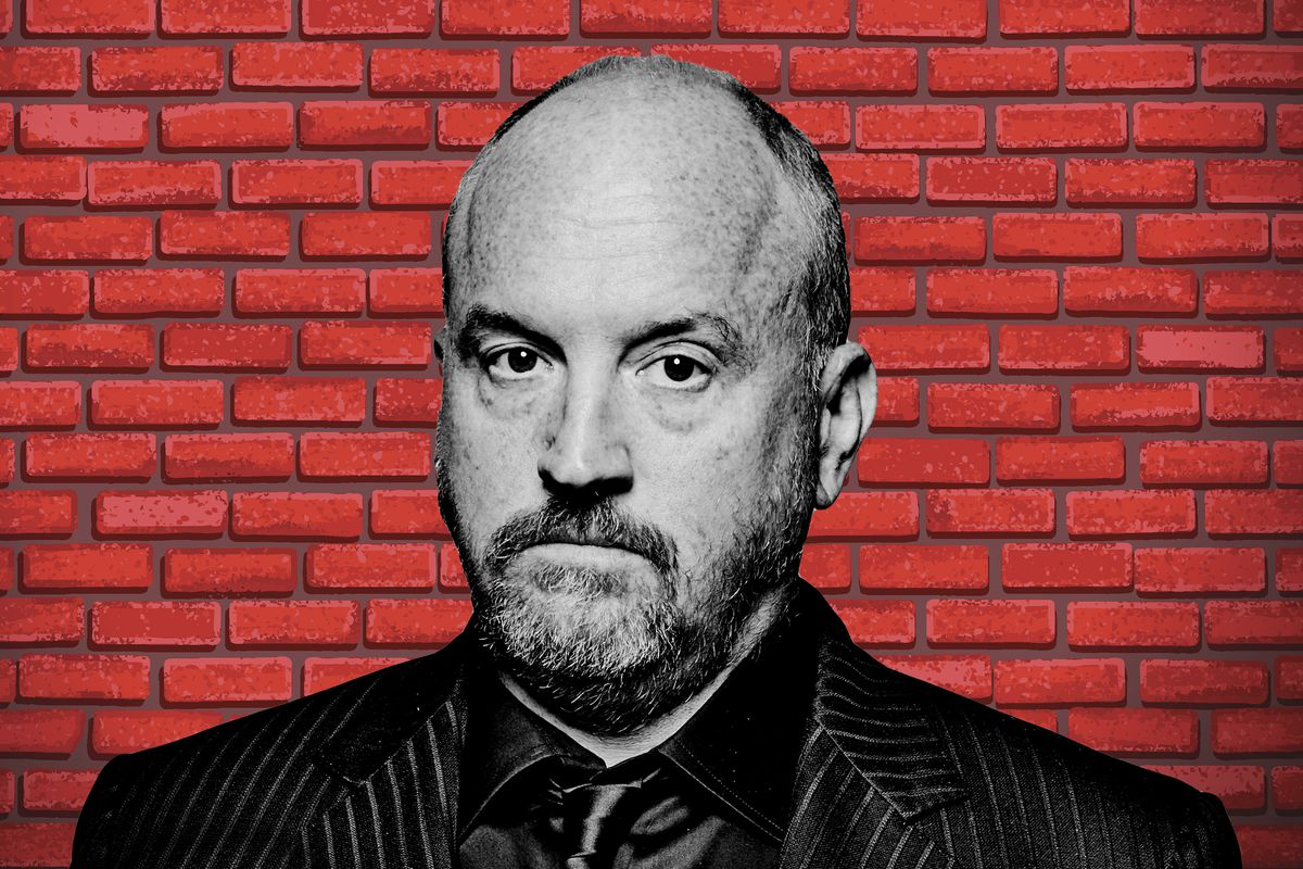 Louis C.K. in front of a brick wall
