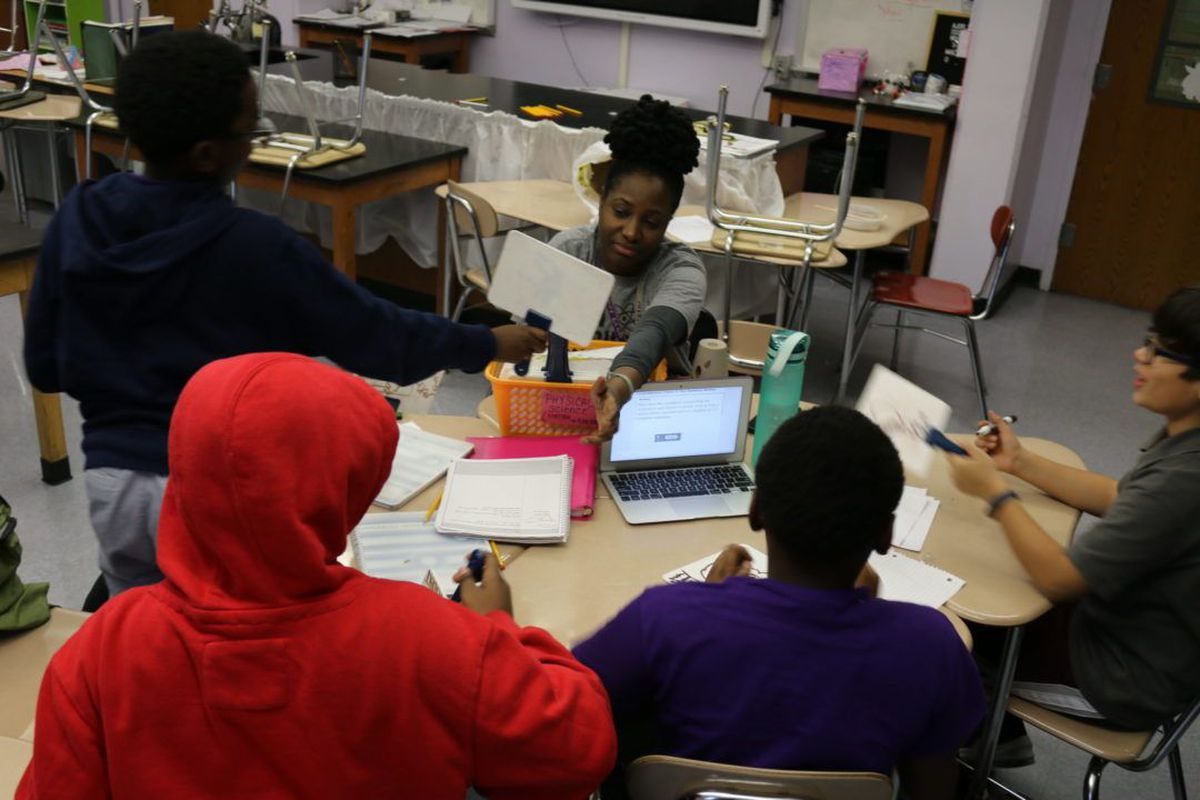 West Prep science teacher Tunisia Bristol quizzes sixth graders during after-school tutoring. The Upper West Side school in District 3 has had to pay for the after school program after the organization that had been running it was shut down amid a struggle to get staffers' background checks cleared.