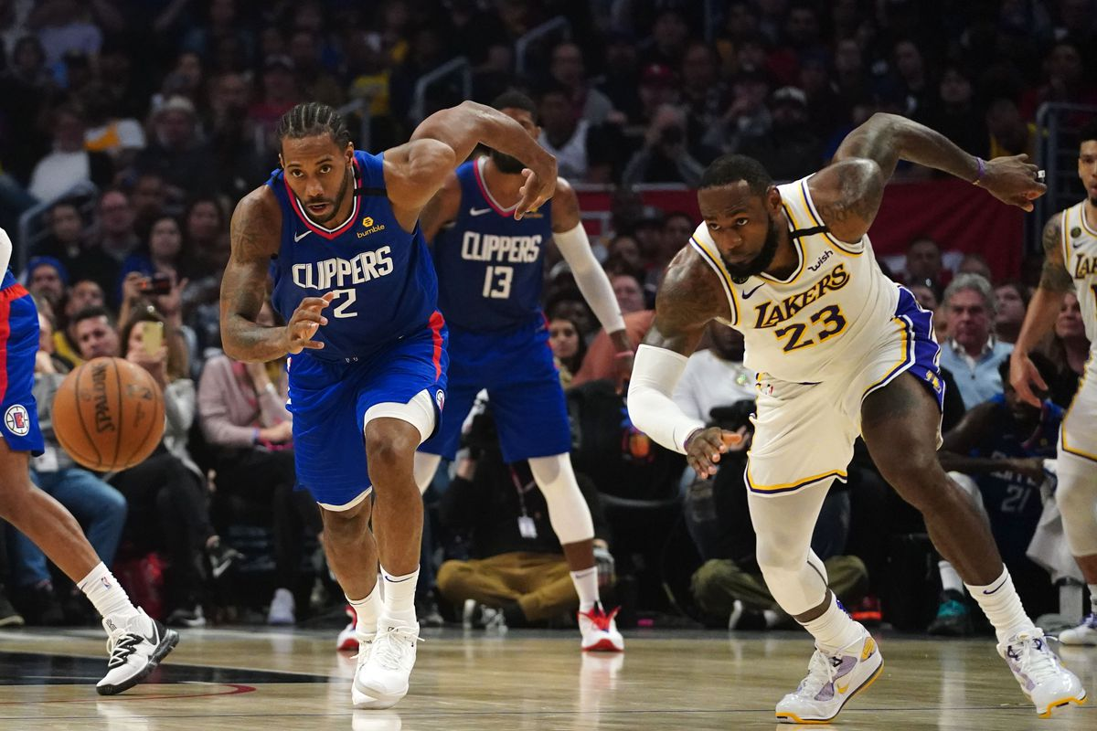LA Clippers forward Kawhi Leonard and Los Angeles Lakers forward LeBron James battle for the ball in the second half at Staples Center. The Lakers defeated the Clippers 112-100.