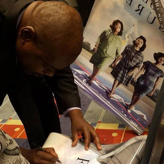 Mathematician Rudy Horne signing autographs at a Congressional Black Caucus Event. | Kimberly F. Sellers / Georgetown University