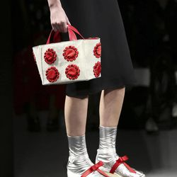 A model wears a creation part of the Prada Women's Spring-Summer 2013 fashion collection, during the fashion week in Milan, Italy, Thursday, Sept. 20, 2012.