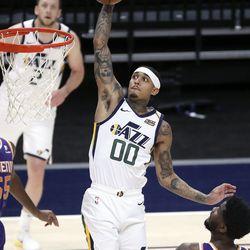 Utah Jazz guard Jordan Clarkson (00) dunks the ball during a preseason NBA game against the Phoenix Suns at the Vivint Smart Home Arena in Salt Lake City on Monday, Dec. 14, 2020. The Jazz beat the Suns 111-92.