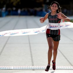 Hurricane's Caila Odekirk places first in the 4A Girls State Cross-Country Championships at Highland High School in Salt Lake City on Wednesday, Oct. 23, 2019.