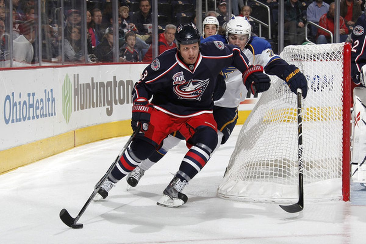 COLUMBUS, OH - MARCH 09:  Marc Methot #3 of the Columbus Blue Jackets keeps the puck from T.J. Oshie #74 of the St. Louis Blues on March 9, 2011 at Nationwide Arena in Columbus, Ohio.  (Photo by Gregory Shamus/Getty Images)