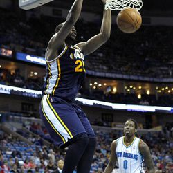 Utah Jazz center Al Jefferson (25) slam-dunks in front of New Orleans Hornets small forward Al-Farouq Aminu (0) in the first half of an NBA basketball game in New Orleans, Friday, April 13, 2012.