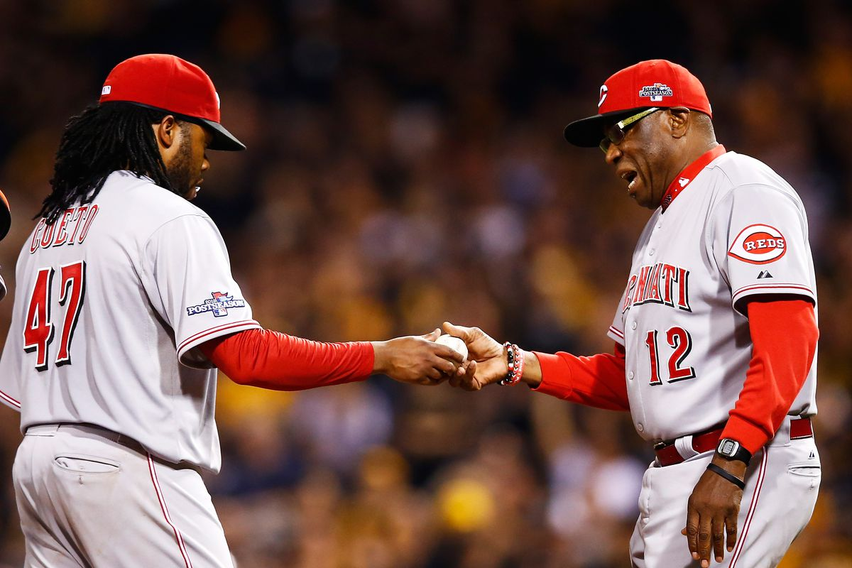 PITTSBURGH, PA - OCTOBER 01:  Manager Dusty Baker #12 pulls Johnny Cueto #47 of the Cincinnati Reds in the fourth inning against the Pittsburgh Pirates during the National League Wild Card game at PNC Park on October 1, 2013 in Pittsburgh, Pennsylvania.  (Photo by Jared Wickerham/Getty Images)