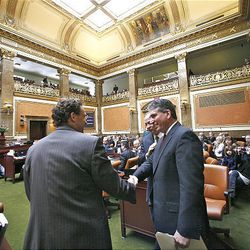 Newly elected Speaker of the House David Clark is congratulated by Representative David Litvack, House Minority Leader at the start of the 2009 session of the Utah Legislature at the Capitol building in Salt Lake City, Monday.