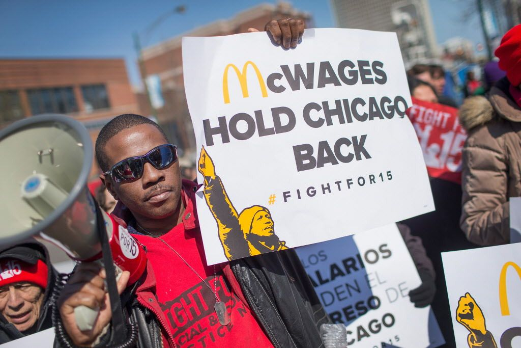Demonstrators demanding an increase in the minimum wage protest in front of a McDonald's restaurant on April 14.   Getty Images