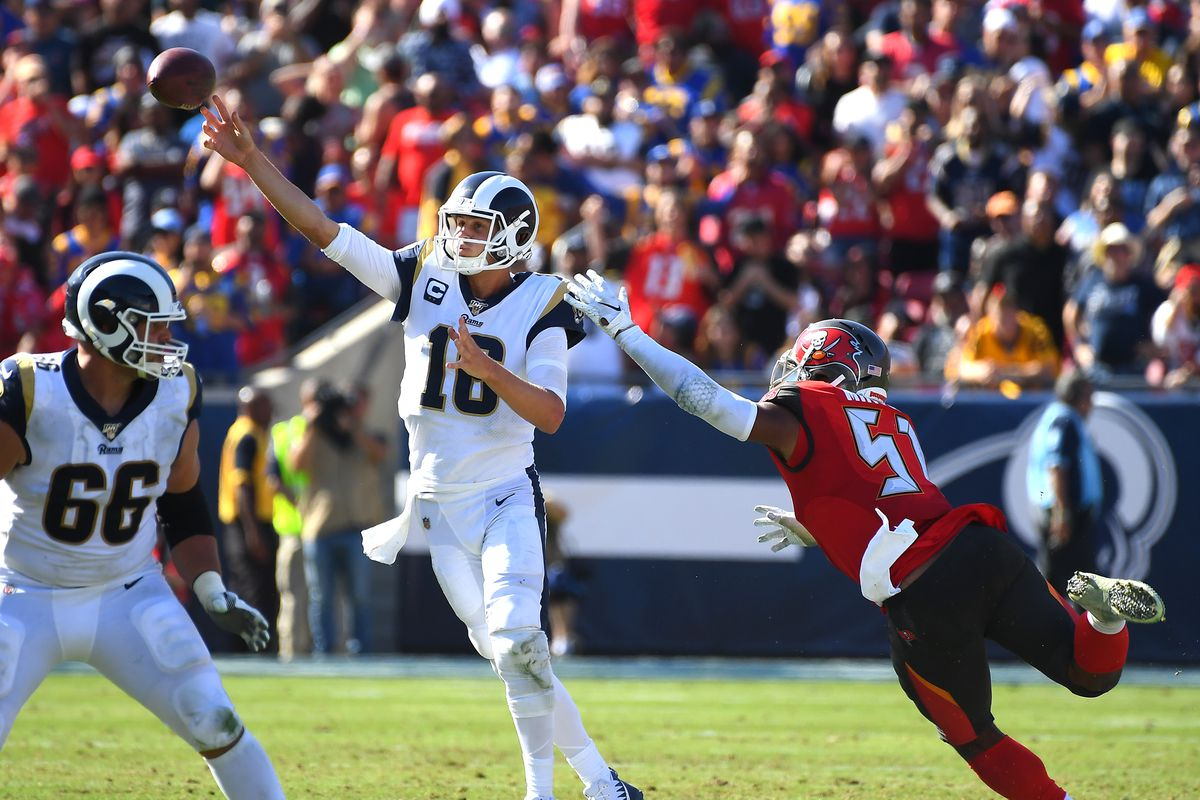 Tampa Bay Buccaneers linebacker Kevin Minter forces Los Angeles Rams quarterback Jared Goff to throw an interception in the second half at the Los Angeles Memorial Coliseum.