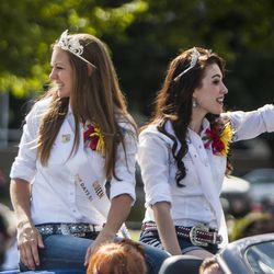 Members of The Days of '47 Royalty wave during the Days of '47 Union Pacific Railroad Youth Parade held Saturday, July 18, 2015, in Salt Lake City.