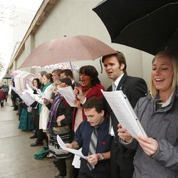 Attendees sing outside Temple Square during the 182nd Annual General Conference for The Church of Jesus Christ of Latter-day Saints in Salt Lake City  Sunday, April 1, 2012.