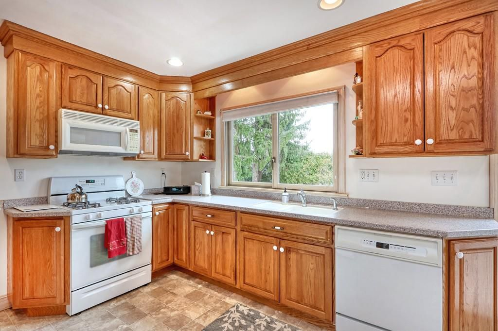 A kitchen with an L-shaped counter.