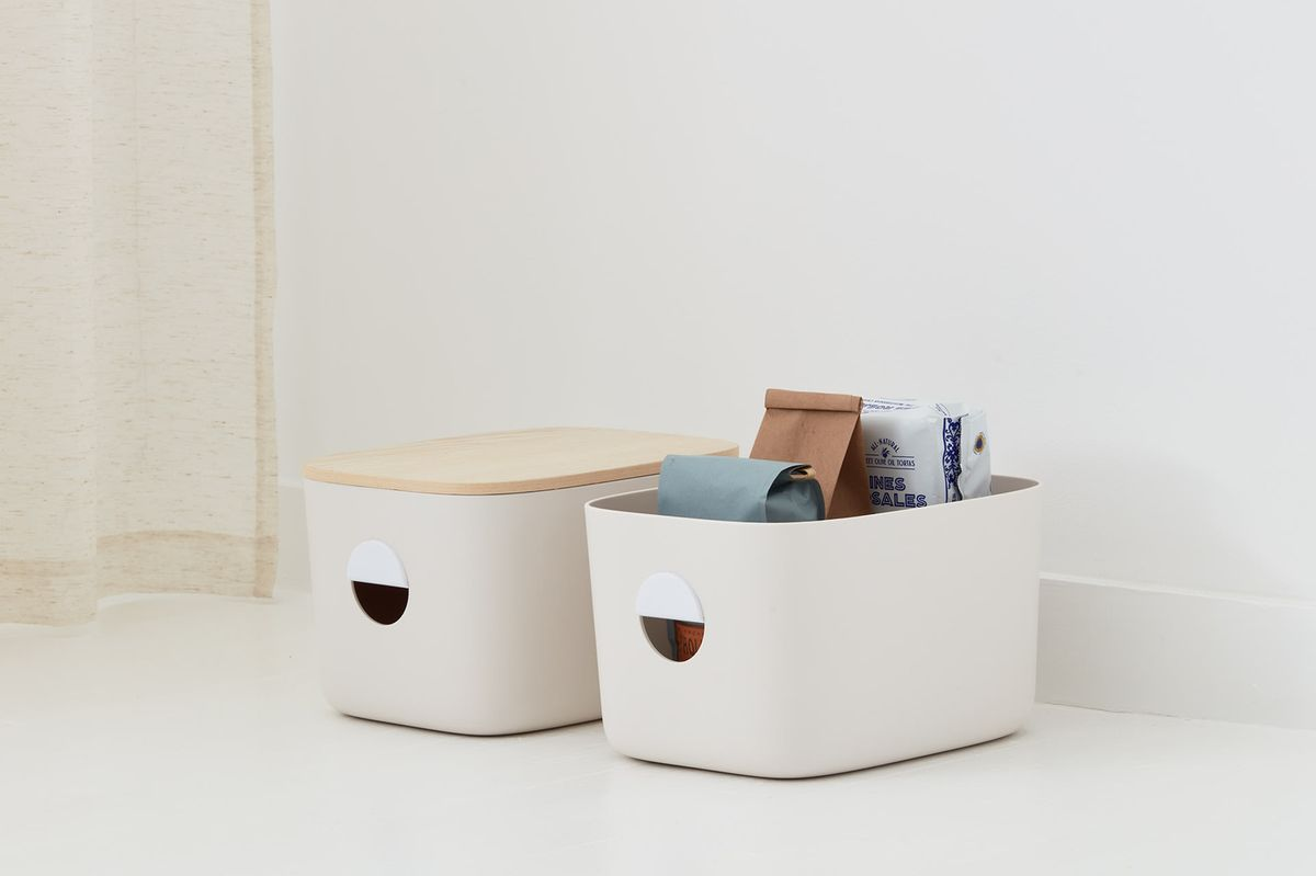 Beige colored bins with a wooden lid.