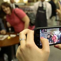 David Archuleta pauses for a cell phone photo at a signing event at the Deseret Book at Ft. Union in Midvale on Nov. 22.