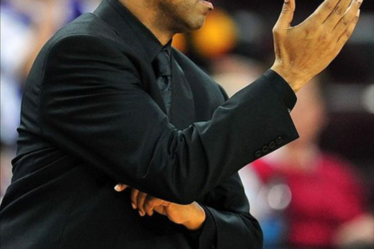 March 1, 2012; Los Angeles, CA, USA; Washington Huskies head coach Lorenzo Romar watches game action against the Southern California Trojans during the second half at Galen Center. Mandatory Credit: Gary A. Vasquez-US PRESSWIRE