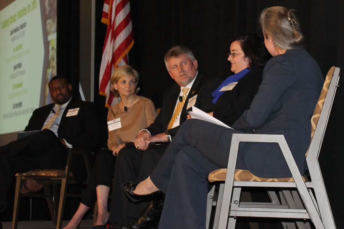 Lyle Ailshie (center) participates in a 2015 panel discussion on the state of education in Tennessee. The event was organized by the State Collaborative on Reforming Education when Ailshie was superintendent of schools in Kingsport.