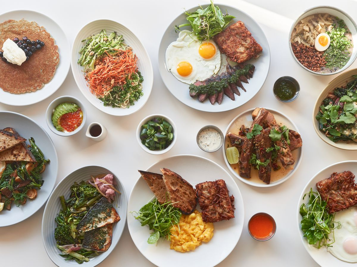 A collection of brunch dishes like pancakes, and steak and eggs at Yang's Kitchen.