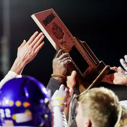 Orem players celebrate their win over Timpview in the 5A football state championship game at Cedar Valley High in Eagle Mountain on Friday, Nov. 20, 2020.