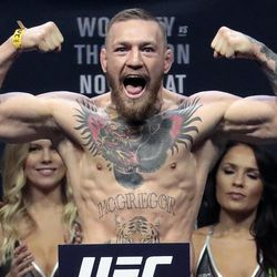 FILE - In this Nov. 11, 2016, file photo, Conor McGregor stands on a scale during the weigh-in event for his fight against Eddie Alvarez in UFC 205 mixed martial arts at Madison Square Garden in New York. Boxer Floyd Mayweather Jr. said Wednesday, June 14, 2017,  he will come out of retirement to face UFC star Conor McGregor in a boxing match on Aug. 26. Mayweather, who retired in September 2015 after winning all 49 of his pro fights, will face a mixed martial arts fighter who has never been in a scheduled 12-round fight at the MGM Grand arena. The fight will take place in a boxing ring and be governed by boxing rules.