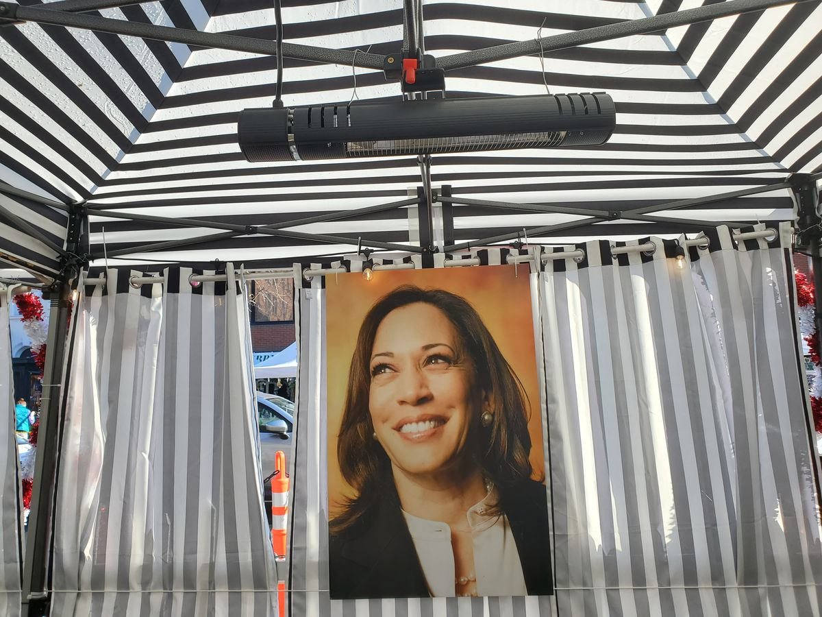 A since-removed poster of Kamala Harris inside Floriana's streetside dining tent